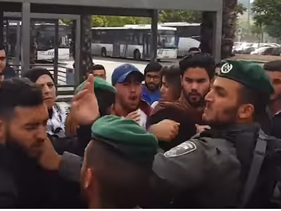 A screenshot of the video shows an Israeli border policeman slapping a demonstrator.