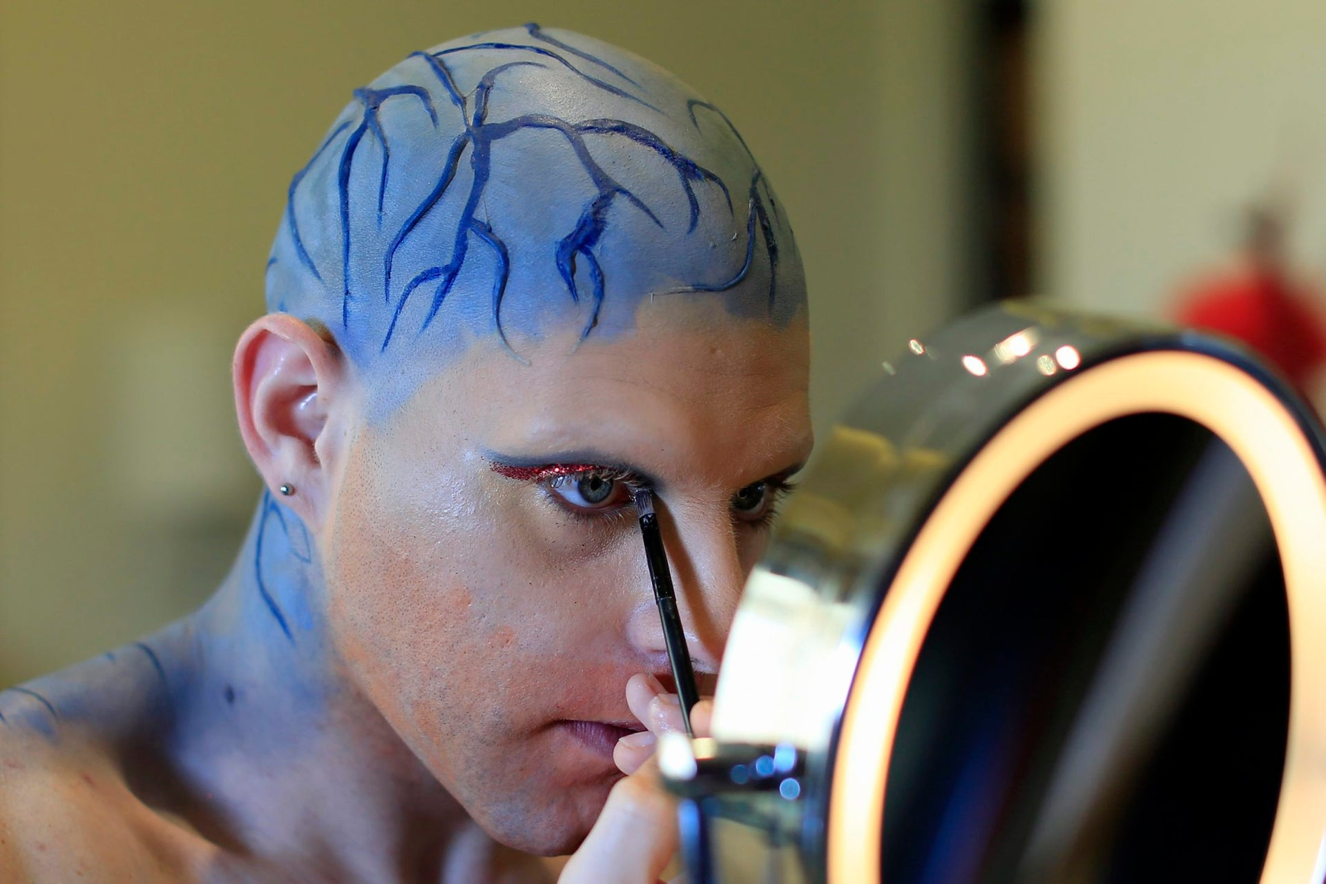 In this picture taken Sunday, May 13, 2018, Elias, 24, who goes by the stage name of Melanie Coxxx, applies make-up before performing in a Sunday drag queen show, called the drag ball, during Beirut Pride week at his home in Tabarja, Lebanon.  Lebanonג€™s relative tolerance emerges in part from its sectarian and ethnic diversity. Despite tensions, no one group is strong enough to impose its will, and people are forced to recognize others to a degree. That has opened up a greater freedom of press, expression and activism than elsewhere in the region.