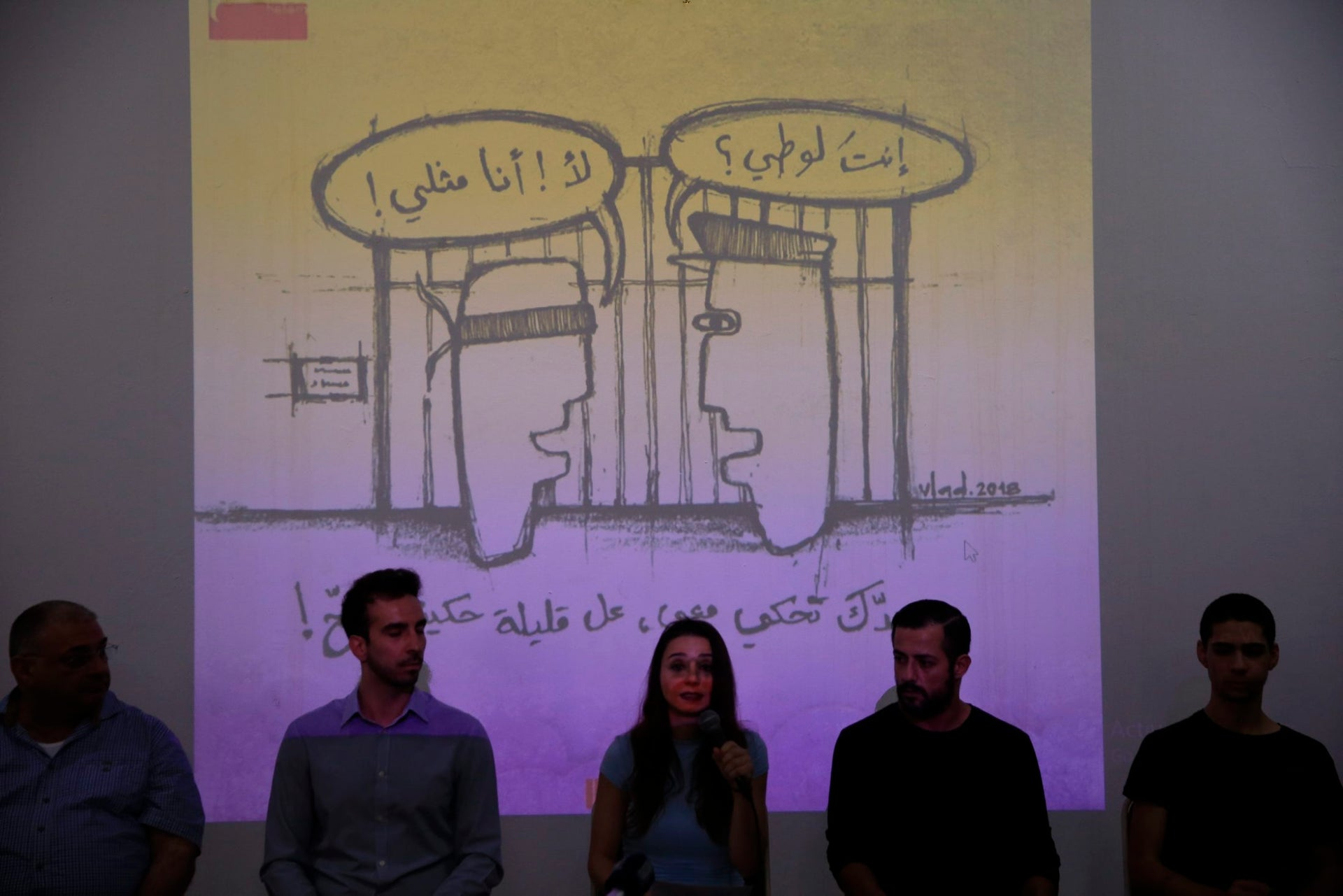 """This picture taken Thursday, May 17, 2018, shows members of Lebanon's pioneering LBGT advocacy group Helem or dream speak during a press conference in Beirut, Lebanon.   Arabic on wall reads """"Are you a sodomite? No I am homosexual, up,. If you want to talk to me, at least do it properly.""""  Lebanonג€™s relative tolerance emerges in part from its sectarian and ethnic diversity. Despite tensions, no one group is strong enough to impose its will, and people are forced to recognize others to a degree. That has opened up a greater freedom of press, expression and activism than elsewhere in the region."""
