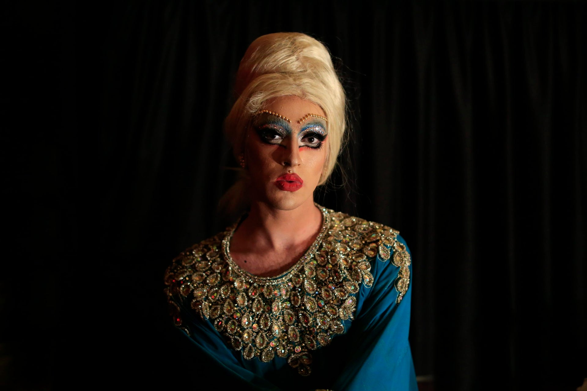 In this picture taken Sunday, May 13, 2018, Drag queen Emma Gration poses for a picture before performs during a Sunday drag queen show, called the drag ball, during Beirut Pride week, north of the capital Beirut, Lebanon.   For the past decade Lebanonג€™s LGBT community  has focused on activism to combat discrimination and abuse, making startling gains and even opening some space in the mainstream. The community is the most vibrant, creative and open in the Arab world.