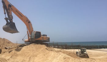 Construction of the sea barrier at Zikim beach, May 27, 2018.
