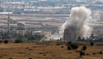 Smoke rises during fighting near the Israel border in Syria, June 17, 2015.