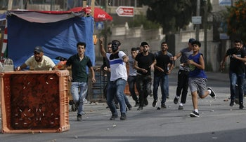 Young Palestinian men clash with Israeli soldiers in the Amari refugee camp near Ramallah on May 28, 2018.