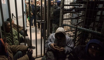 File Photo: Palestinian laborers at the Sha'ar Ephraim checkpoint in 2014.