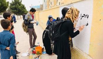 """""""Rabia's Girls"""" with painters in the Balkh province initiate a campaign #LetMeGoToSchool as the school year starts. Painting on walls to illustrate the dreams of the Afghan girls were part of the campaign"""