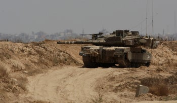An Israeli tank near the border fence with the Gaza Strip, May 28, 2018.