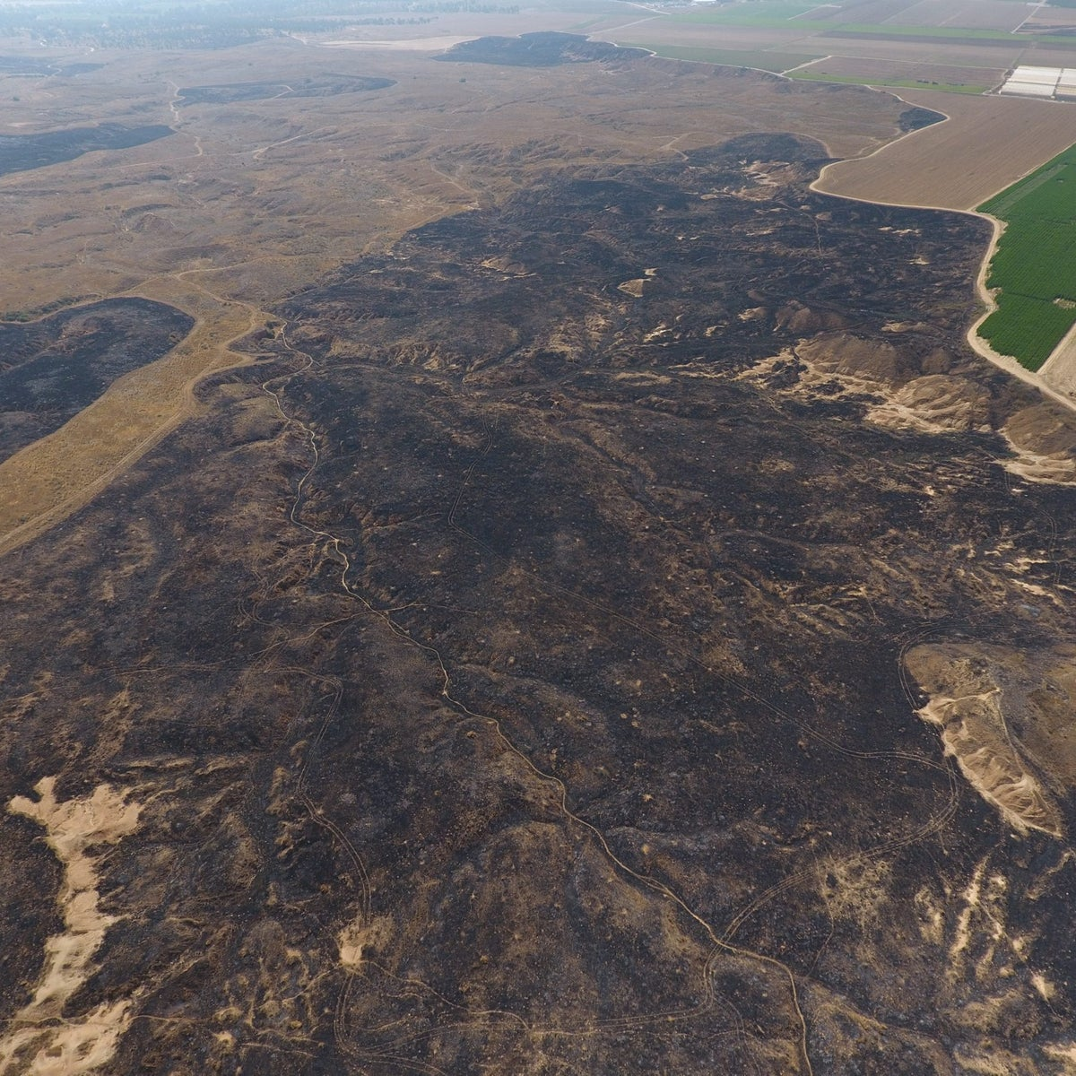 A drone photo shows the crater after the fire in Be'eri.