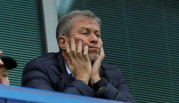 In this file photo dated Saturday, Dec. 19, 2015, Chelsea soccer club owner Roman Abramovich sits in his box before the English Premier League soccer match between Chelsea and Sunderland at Stamford Bridge stadium in London
