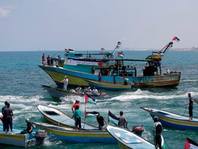 Fishing boats carrying a group of Palestinian activists who are protesting and perhaps trying to breach Israel's naval blockade on Gaza, setting to sail from Gaza City harbour, May 29, 2018.