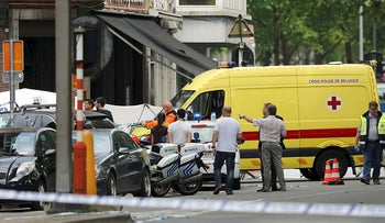 An ambulance car is seen on the scene of a shooting in Liege, Belgium, May 29, 2018