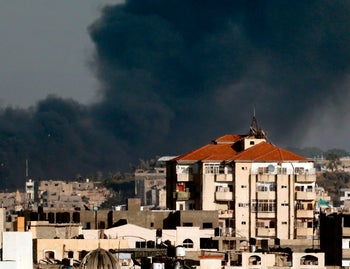 Smoke billowing in the background following an Israeli air strike on Gaza, May 29, 2018.