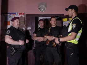 Ukrainian police officers guard in the entrance to a house where Russian journalist Arkady Babchenko was shot and died of his wounds in an ambulance, in Kiev, Ukraine May 29, 2018.