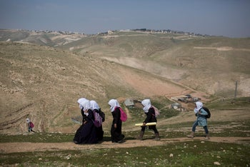 Girls going to school in the Bedouin village of Khan al-Ahmar, which is set to be demolished.