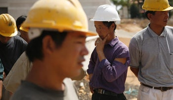 Chinese workers at a construction site in Israel