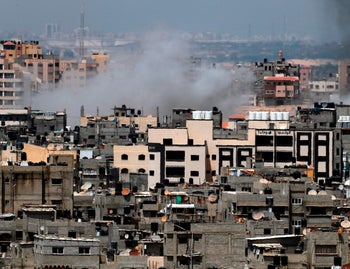 Smoke billowing in the background following an Israeli air strike on Gaza, May 29, 2018