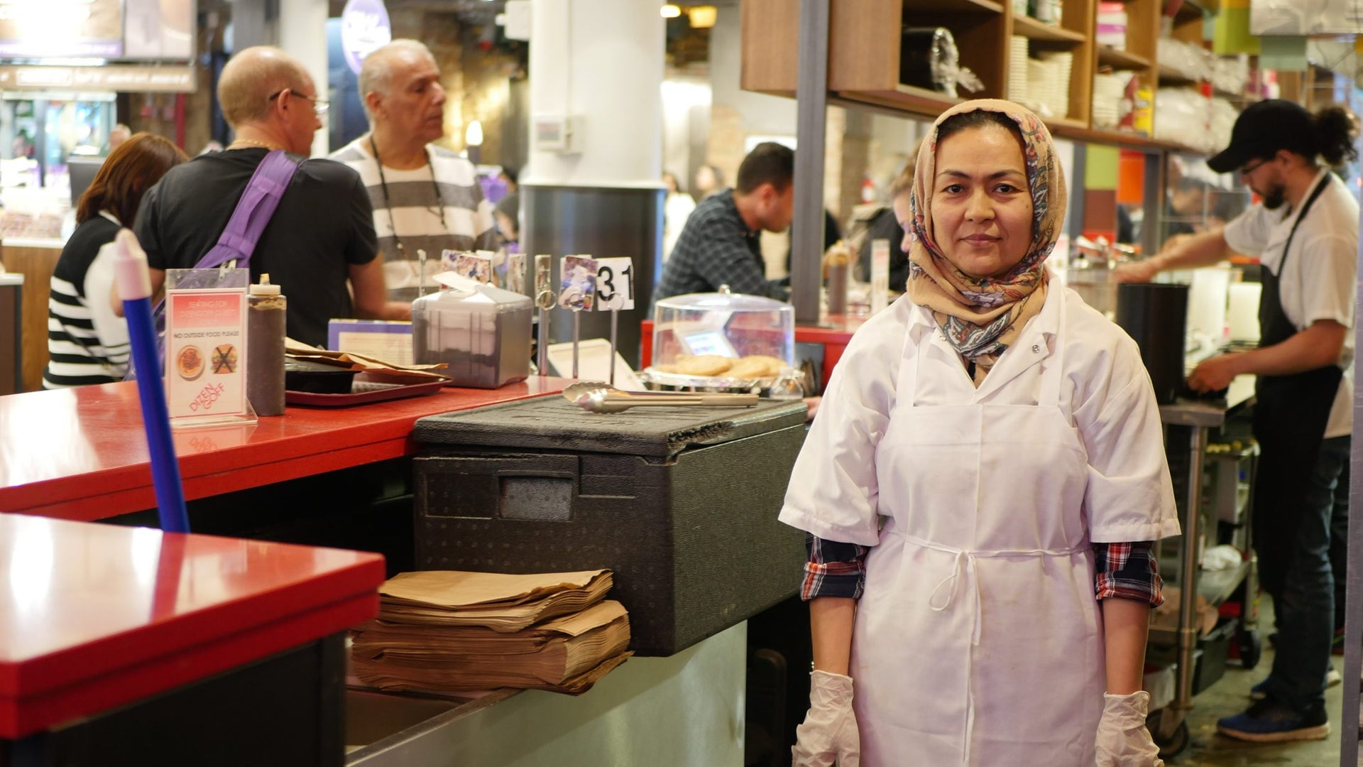 Naseema Bakhshi, an Afghani refugee and graduate from the Emma's Torch program, working at the Dizengoff kitchen in Chelsea Market, New York.