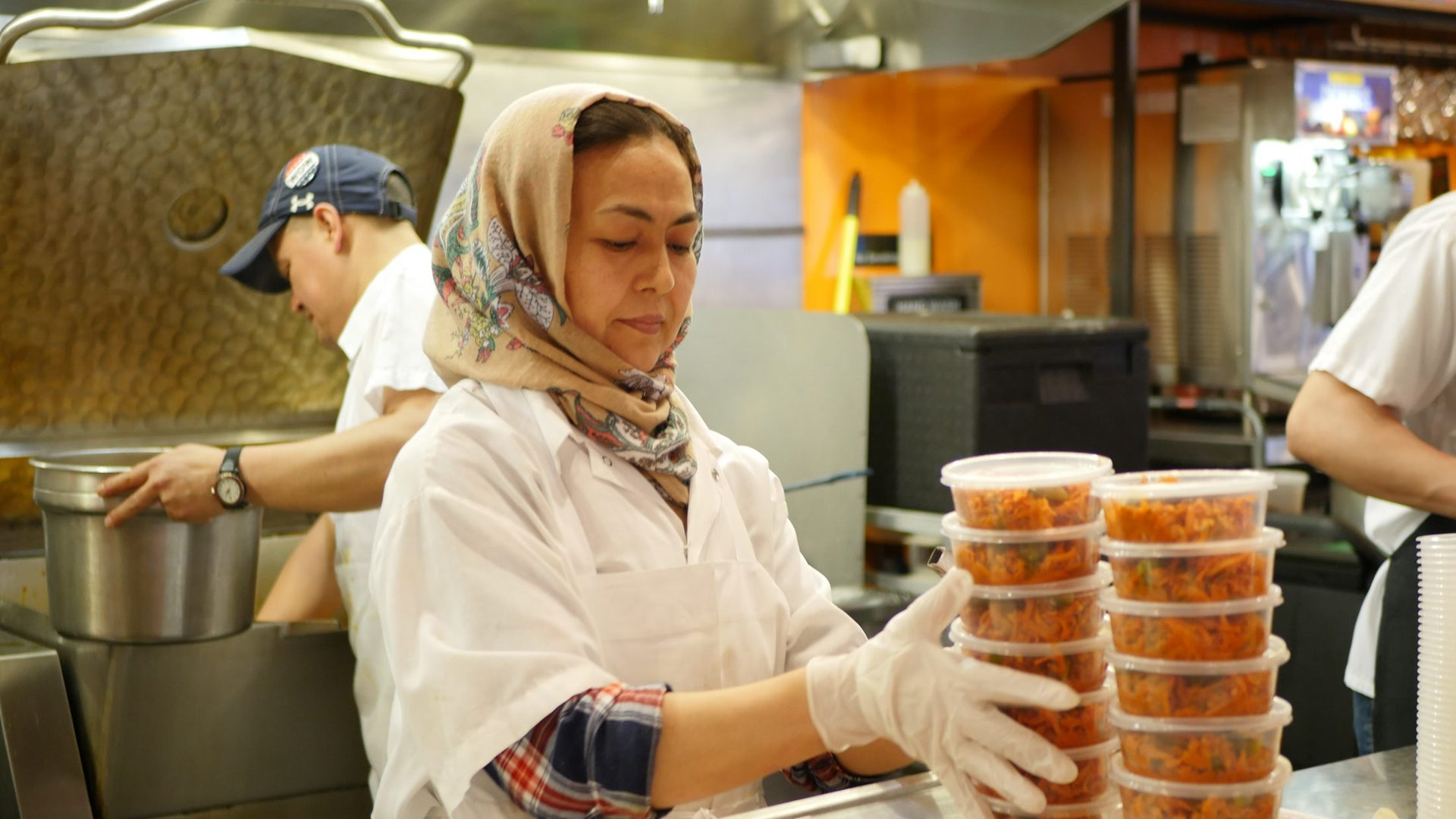 "Afghan refugee Naseema Bakhshi working at the Dizengoff kitchen in New York. ""I came with nothing, but now I have everything"" she says."