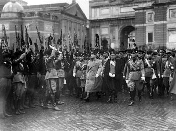 Italian dictator Benito Mussolini is greeted by some of his troops in the Piazza Popolo, Rome, March 28, 1928, celebrating the founding of the Fascist Army nine years before.