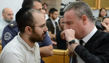 Nadav Sela (L) and his attorney in court, May 30, 2018.