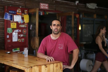 Yigal Hanoch, the kitchen manager at Hahummus Shel Thina, a popular eatery.
