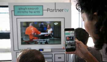 Observers at a launch event for Partner TV in 2017.