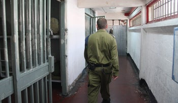 Israeli soldier walks away from camera in military prison, 2014