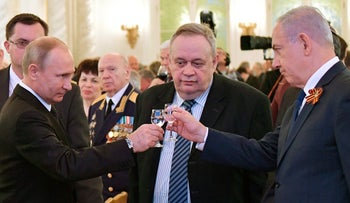 Putin and Netanyahu toast during a reception in Moscow, Russia, May 9, 2018.