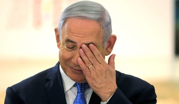 Israeli Prime Minister Benjamin Netanyahu gestures during a special cabinet meeting marking Jerusalem Day, at the Bible Lands Museum in Jerusalem May 13, 2018.