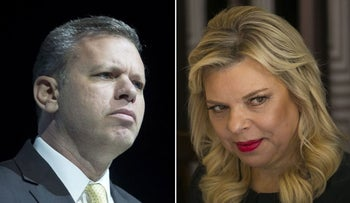 The director general of the Prime Minister's Office, Eli Groner, and Sara Netanyahu.