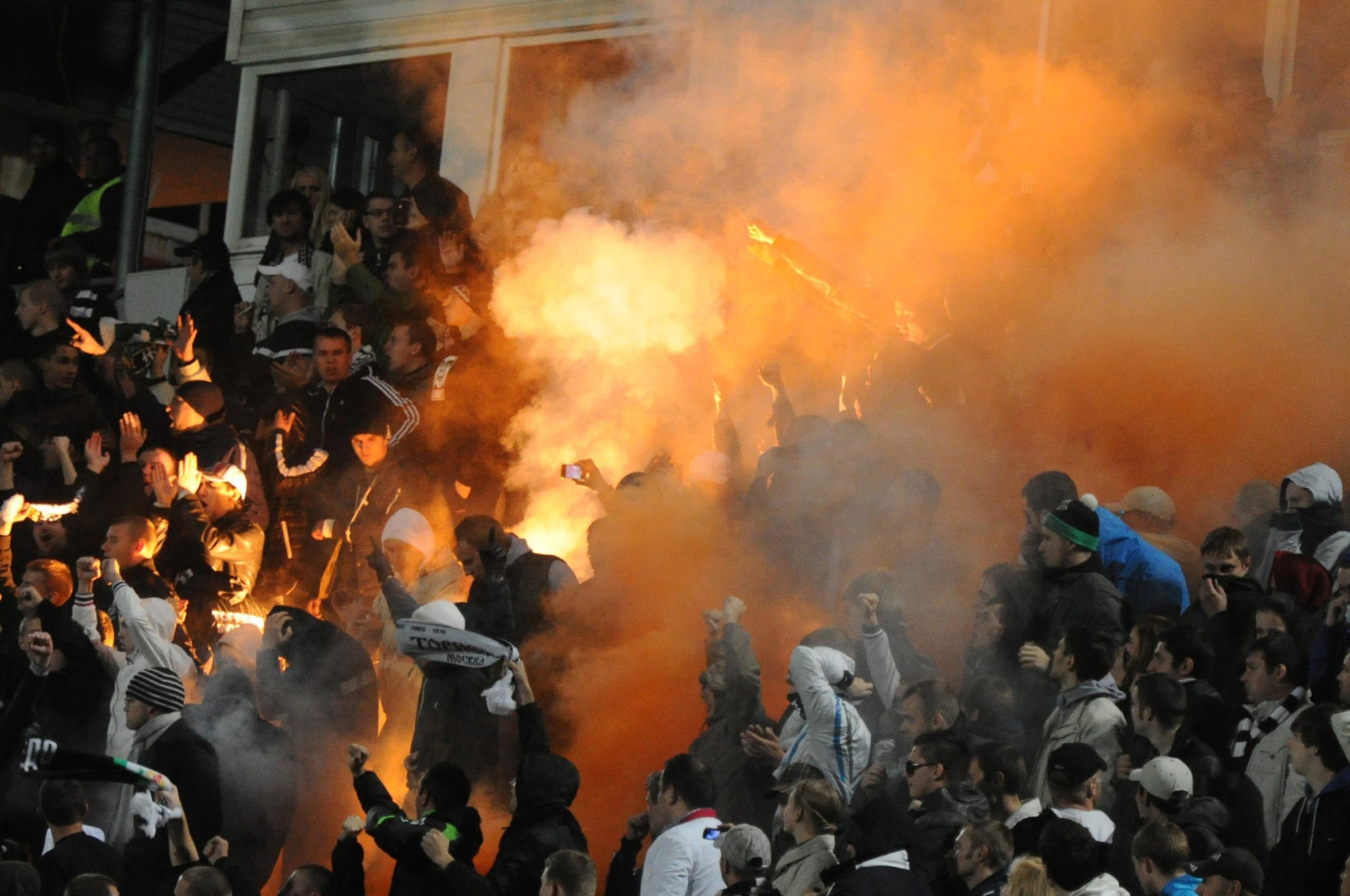 Russian soccer fans light flares during a fourth round Russia Cup match between Dinamo Moscow and Torpedo Moscow at the Eduard Streltsov Stadium in Moscow, on September 26, 2012.