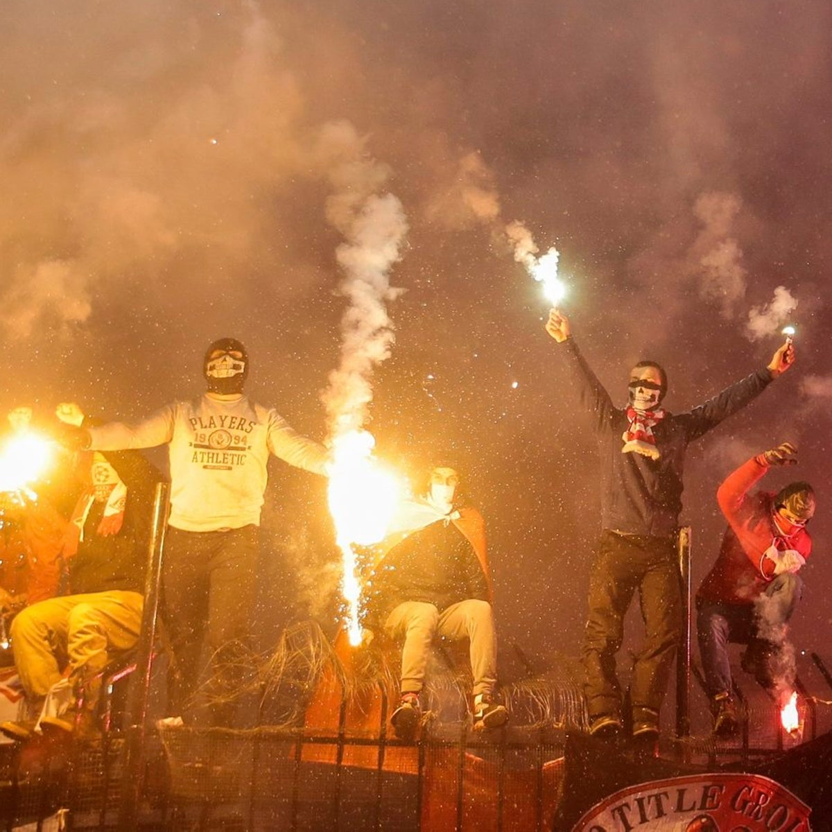 Russian soccer fans of the Spartak team burn flares during a Russian Premier League Championship soccer match between Arsenal Tula and Spartak Moscow in Tula, Russia, Dec. 1, 2017.
