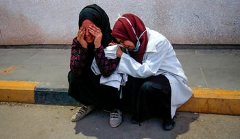 Palestinian paramedics mourn over the death of their colleague Razan Najjar, Gaza Strip, June 1, 2018