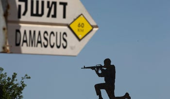 A mock road sign for Damascus, the capital of Syria, and a cutout of a soldier, are displayed in an old outpost in the Israeli controlled Golan Heights near the border with Syria, Thursday, May 10, 2018. Israel says it struck dozens of Iranian targets in Syria overnight in response to a rocket barrage on Israeli positions in the Golan Heights. It was the biggest Israeli strike in Syria since the 1973 war. (AP Photo/Ariel Schalit)