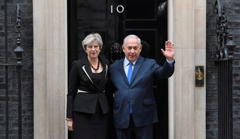 Britain's Prime Minister Theresa May welcomes Israel's Prime Minister Benjamin Netanyahu outside 10 Downing Street in London, Britain, November 2, 2017
