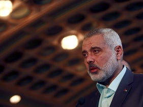 Senior Hamas leader Ismail Haniyeh talks during a news conference with Arab League Secretary General Nabil al-Arabi after their meeting at the Arab League headquarters in Cairo December 26, 2011