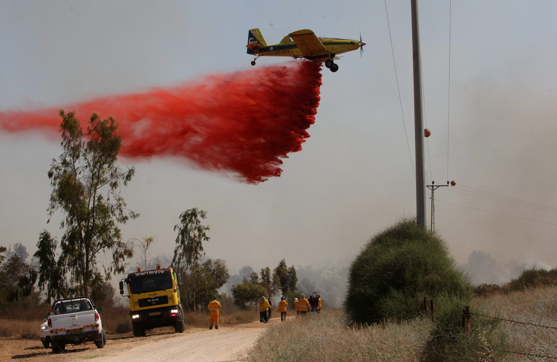 An aircraft and firefighting crew seen  in the Israeli community of Or Haner on June 3, 2016.