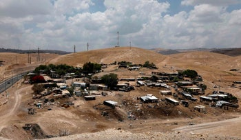 A general view taken on May 30, 2018 shows the Khan al-Ahmar Bedouin village, a village which is located between the West Bank city of Jericho and Jerusalem near the Israeli settlement of Maale Adumim and is under a demolition order.