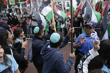 NEW YORK, NY - JUNE 03: Pro-Palestine protestors demonstrate during the annual Celebrate Israel Parade on June 3, 2018 in New York City. Security will be tight for the parade which marks the 70th anniversary of the founding of Israel.   Kena Betancur/Getty Images/AFP == FOR NEWSPAPERS, INTERNET, TELCOS & TELEVISION USE ONLY ==