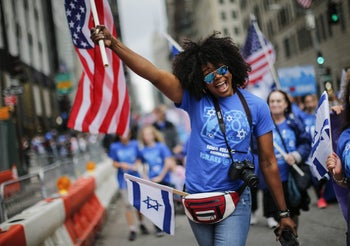 NEW YORK, NY - JUNE 03: People march during the annual Celebrate Israel Parade on June 3, 2018 in New York City. Security will be tight for the parade which marks the 70th anniversary of the founding of Israel.   Kena Betancur/Getty Images/AFP == FOR NEWSPAPERS, INTERNET, TELCOS & TELEVISION USE ONLY ==