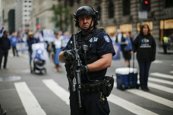 NEW YORK, NY - JUNE 03: A NYPD officer stands guard during the annual Celebrate Israel Parade on June 3, 2018 in New York City. Security will be tight for the parade which marks the 70th anniversary of the founding of Israel.   Kena Betancur/Getty Images/AFP == FOR NEWSPAPERS, INTERNET, TELCOS & TELEVISION USE ONLY ==