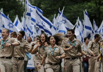 Illustrative photo: Members of the Israel Boy and Girl Scouts Federation participate in the annual Celebrate Israel Parade on June 3, 2018 in New York City. Security will be tight for the parade which marks the 70th anniversary of the founding of Israel.