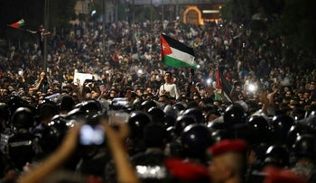 Jordanian protesters at a demonstration outside the Prime Minister's office in Amman, early Monday, June 4, 2018.