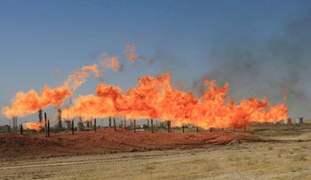 Flames emerge from flare stacks at the oil fields in Kirkuk, Iraq October 18, 2017