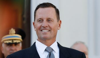 U.S. Ambassador to Germany Richard Allen Grenell stands in front of a military honor guard during an accreditation ceremony for new Ambassadors in Berlin, May 8, 2018.