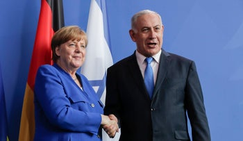 German Chancellor Angela Merkel and Prime Minister Benjamin Netanyahu shaking hands after a news conference in Berlin, June 4, 2018.
