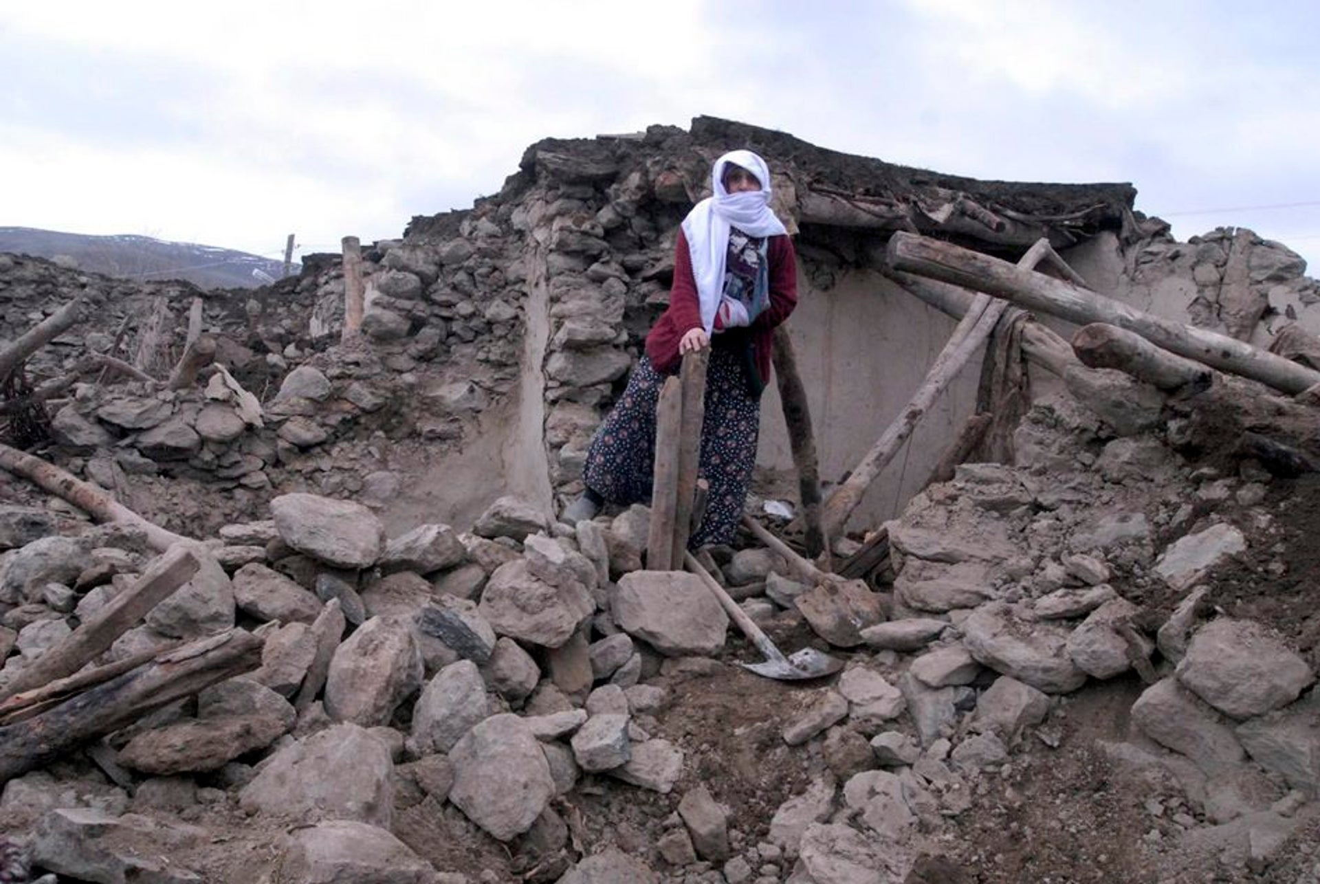 Standing on the ruins of a destroyed house in Okcular, a village in Elazig, Turkey, March 8, 2010: A strong earthquake killed 41 villagers when it struck at 4:32 am local time. The quake had a magnitude of 6.0 and was followed by 30 minor aftershocks.