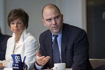 Ben Rhodes speaks during an interview in Washington, with another Obama adviser, Valerie Jarrett, to his right, January 15, 2016.