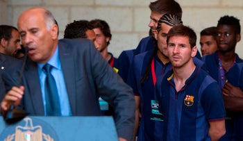 Argentinian forward Lionel Messi looks on as Jibril Rajoub speaks in Bethlehem, August, 2013