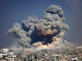 Smoke and fire from an Israeli strike rise over Gaza City during the last round of sustained conflict between Israel and Gaza. July 29, 2014.
