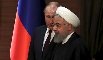 Russian President Vladimir Putin and his Iranian counterpart Hassan Rouhani arrive for a joint news conference after their meeting in Ankara, Turkey April 4, 2018